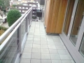 balcony-roof-design-grey-concrete-pavers-flooring-tiles-images